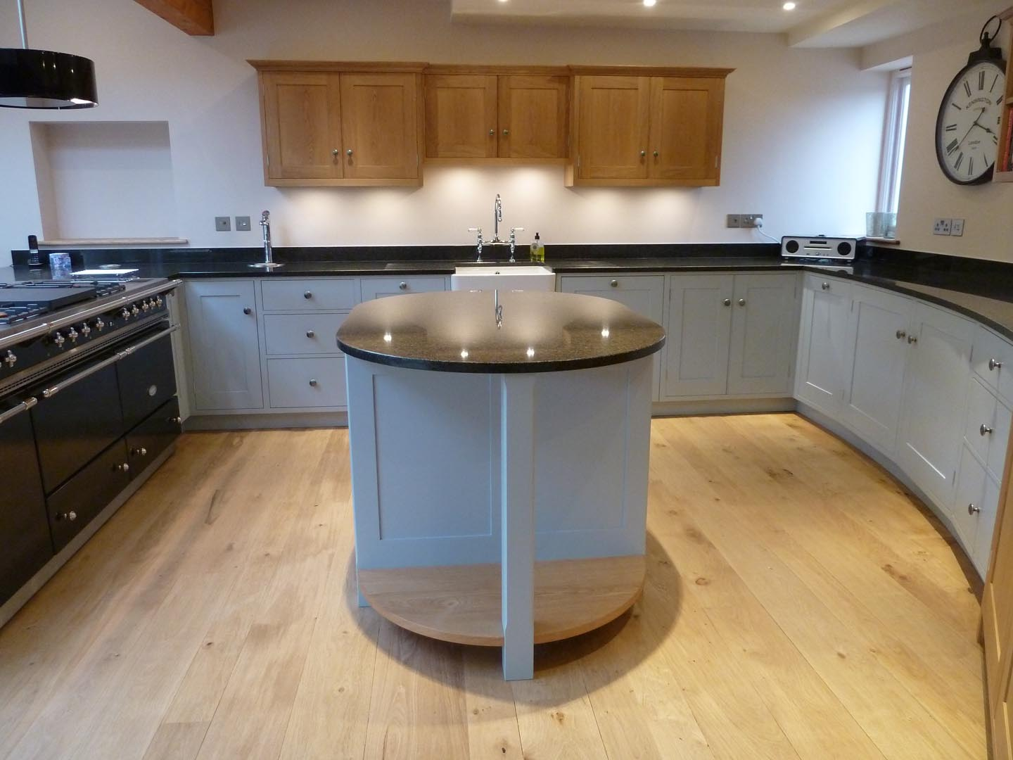 Modern Oak and painted kitchen with a curved/serpentine wall